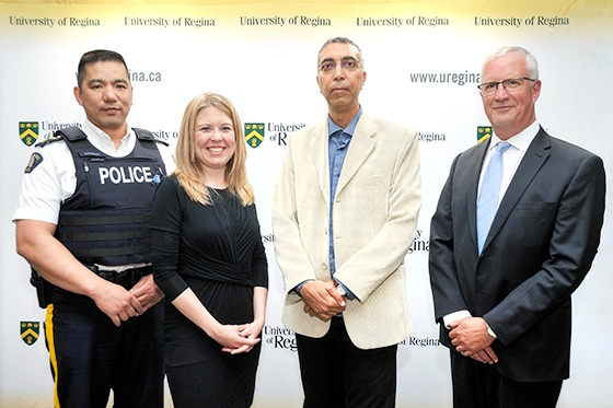 (L to R) Superintendent Alfredo Bangloy, Assistant Criminal Operations Officer at RCMP F Division Headquarters in Regina; Michelle Rempel, Minister of State for Western Economic Diversification; Dr. Yasser Morgan, Associate Professor in the Faculty of Engineering and Applied Science; Dr. Thomas Chase, Provost and Vice President (Academic). (Photo courtesy of Trevor Hopkin - U of R Photography)